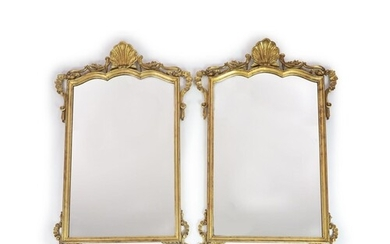 A pair of Georgian style carved giltwood wall mirrors, with ...