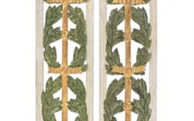A pair of carved, pierced, painted and gilt soft wood wall panels
