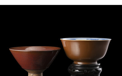 A red glaze bowl and a brown glaze bowl, one with wood stand China, 19th century (d. max 12 cm.)Read more