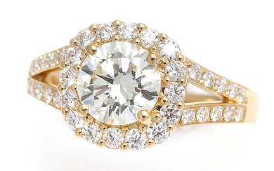 A ring set with a diamond weighing app. 1.37 ct. and numerous diamonds weighing a total of app. 0.61 ct., mounted in 18k gold. Size app. 54. – Bruun Rasmussen Auctioneers of Fine Art