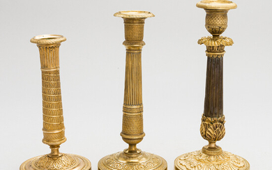 A set of three empire candlesticks, first half of the 19th century.