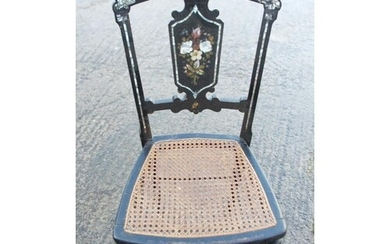 An Arts & Crafts ebonised spindle back bedroom chair, on tur...