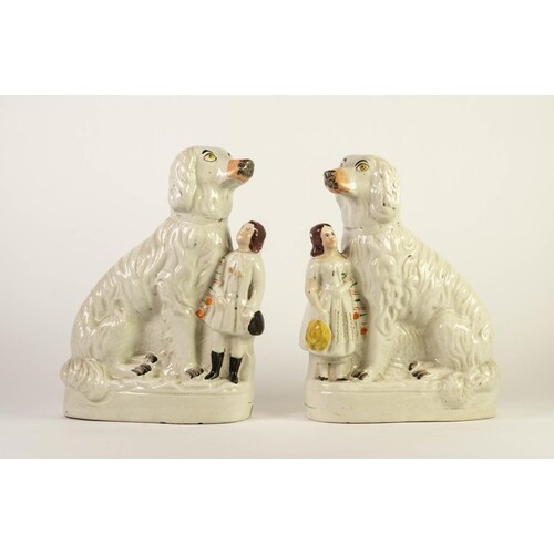 PAIR OF VICTORIAN STAFFORDSHIRE MANTLE DOG POTTERY GROUPS, e...