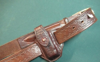 Quality tooled leather belt with brass buckle marked Harry B...