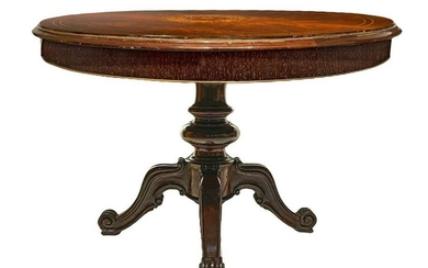 Round table with four-spoke central foot in solid