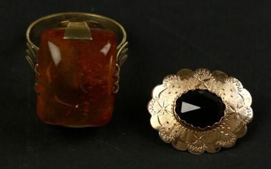14k yellow gold brooch set with a rose-cut garnet, and...