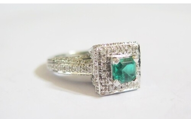 A 14ct White Gold, Emerald and Diamond Ring, emerald 5.5mm, ...