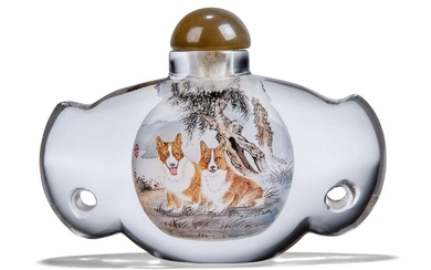 A Chinese inside-painted glass 'dogs' snuff bottle, 20th century, decorated to one side with a pair of corgis beneath a tree, the reverse with a golden retriever and an inscription, both sides with red artist seals, 8cm high