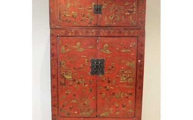 A Chinese red lacquer chinoiserie two piece cabinet, early 2...