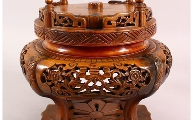 A JAPANESE MEIJI PERIOD CARVED WOODEN REVOLVING VASE STAND, ...