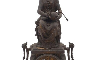 A cast iron mantle clock, 20th Century, the case of architectural stepped plinth form with scrolling lyre handles, surmounted by a seated greco-roman female figure and raised on four feet, the cast iron dial set with enamel roundels painted with...