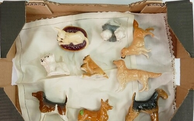 A collection of small Beswick dogs (9)