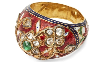 A diamond-set enamelled gold bombe ring, India, 19th century, the bezel set with a flower set with diamonds and central emerald, further flowers set with diamonds, on a red enamel ground with blue border, the shoulders with enamel flowers on a...