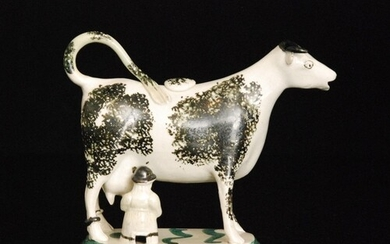 A late 18th to early 19th Century Staffordshire cow creamer ...