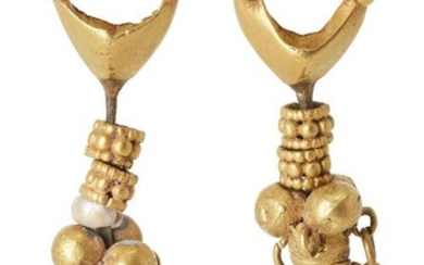 A pair of seed pearl leaf and roundel gold pendant earrings in the ancient style, each approx. 5cm. high, 11 grams (2) Provenance: Private Collection Oliver Hoare (1945-2018); acquired Antiquari F. Cervera Arqueologica, Madrid Spain 2 December 1996
