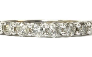 A white gold diamond half eternity ring