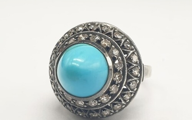 AN ANTIQUE SILVER RING WITH DIAMONDS AND TURQUOISE IN AN ART...