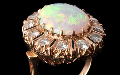 AN OPAL AND DIAMOND CLUSTER DRESS RING