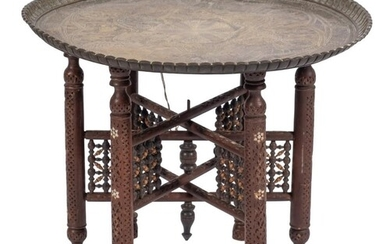 An Indian brass circular Tiffin table:, decorated with figur...