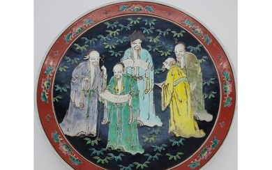 An early 20th century Japanese Wall charger depicting Schola...