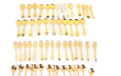 NOT SOLD. Collection of gilt sterling silver annual cutlery with enamel. Georg Jensen. Weight c....