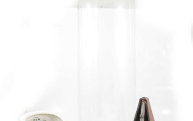 Glass dome with stand, slipper shape chamber pot, and metronome