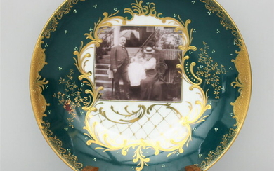 Photo wall plate of porcelain with a green and gold...