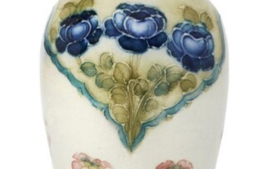 William Moorcroft (British 1872-1945), a Moorcroft Macintyre 'poppy and forget-me-knot' miniature ceramic vase, c.1908-9, signed in green 'WM', printed Macintyre roundel, The shouldered oviform decorated with fine tube-lining and colours with...
