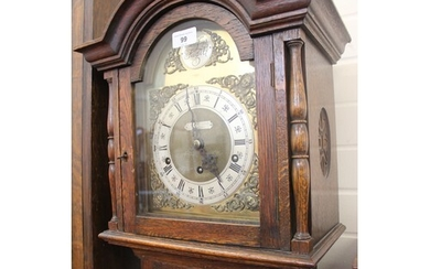 A 20th century oak grandmother clock, with arched dial, reta...