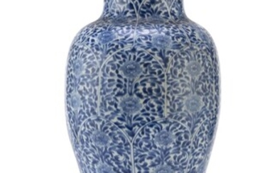 A CHINESE WHITE AND BLUE PORCELAIN VASE 19TH CENTURY.