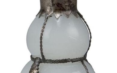 A Chinese white metal mounted Peking glass snuff bottle, 20th century, of gourd form, the glass of opaque quality encased in white metal, the cover set with coral and green hardstone cabochons, 9cm high