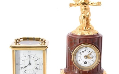 A French gilt metal and veined red marble mantel clock case in late 19th century taste