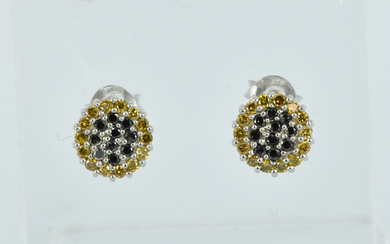 A PAIR OF DIAMOND AND SILVER STUD EARRINGS
