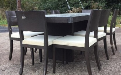 A contemporary rectangular dining table with eight chairs, the...