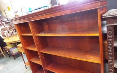 A mahogany bookcase with six adjustable shelves
