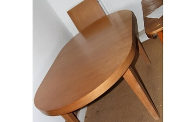 A modern cherrywood oval extending dining table with extra l...