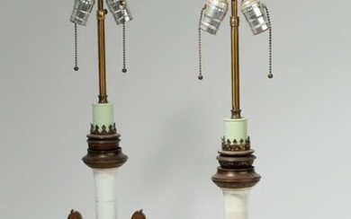 A pair of bronze mounted white glass lamps