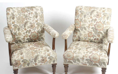 A pair of early 20th century oak framed arm chairs.