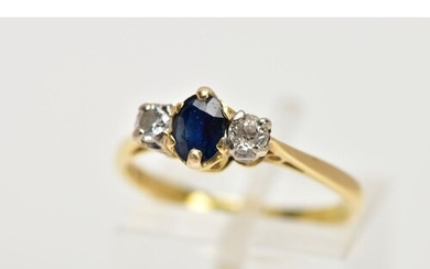 AN 18CT GOLD SAPPHIRE AND DIAMOND THREE STONE RING, centring...