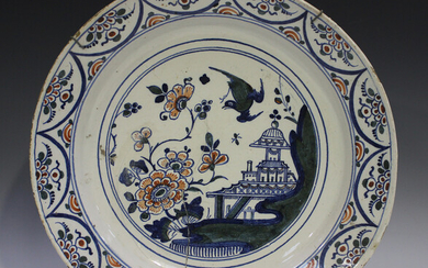 An English Delft charger, Bristol, 18th century, painted in blue, green and red with a chinoiserie p