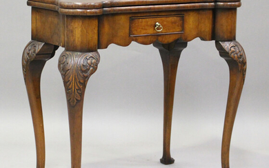 An early 20th century George I style walnut fold-over card table, fitted with a drawer, on cabriole