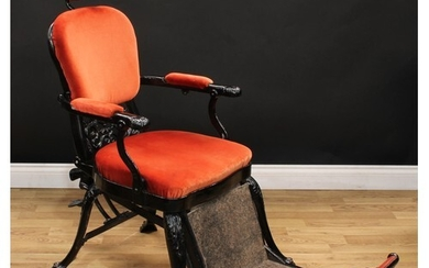 An early 20th century cast iron barber or dentist chair, tel...