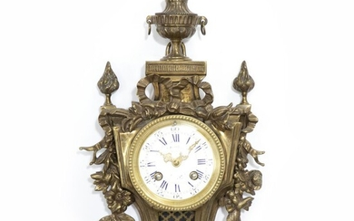 French Louis XVI style bronze wall clock with white enamel dial. Traces of signature on the dial. Late 19th century. H. 40 cm. W. 22 cm. – Bruun Rasmussen Auctioneers of Fine Art