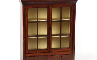 Property of a lady - a mahogany glazed two-door wall cabinet...